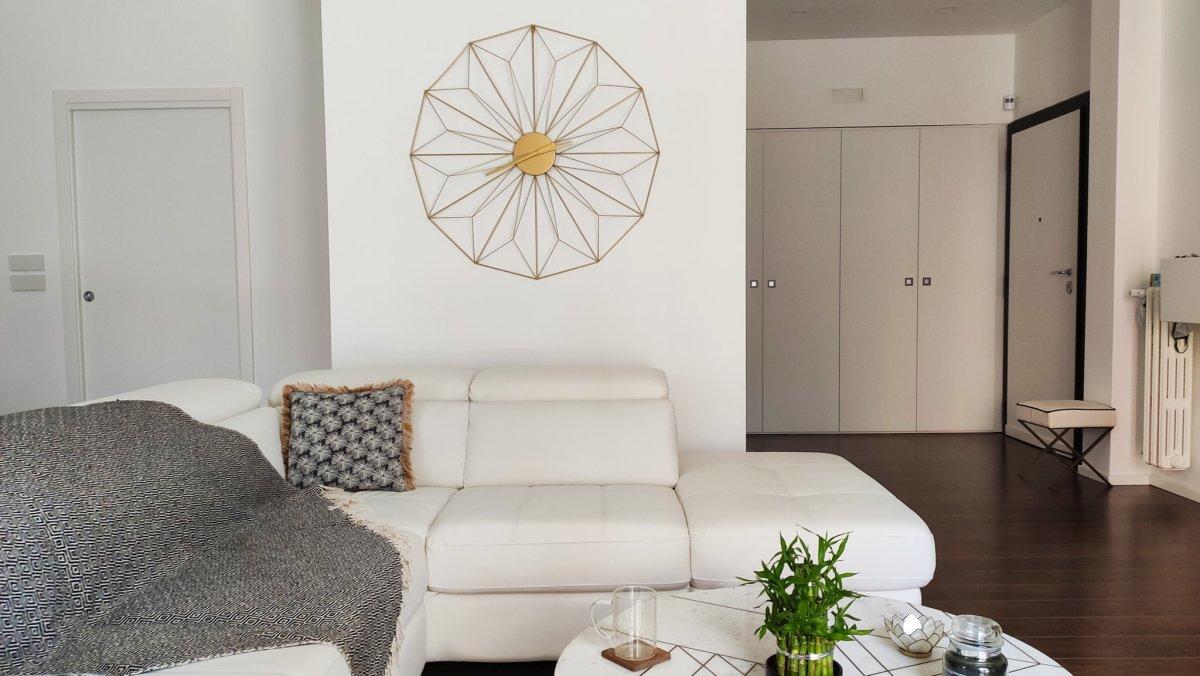 Orologi da parete di design living room, salone, soggiorno e open space